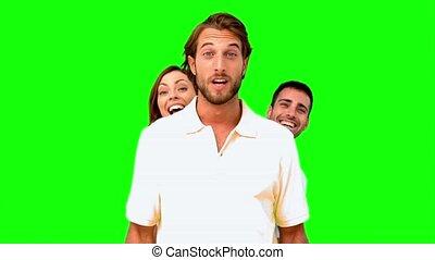 Friends hiding behind a man - : Friends hiding behind a man...