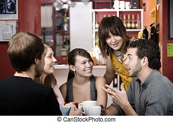 Friends in a Coffee House - Five young friends in a coffee...