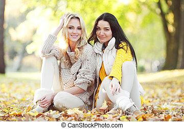 Friends in autumn park