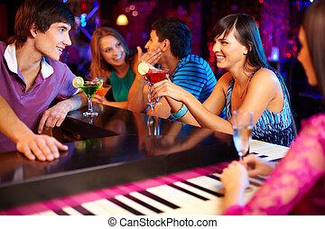 Friends in bar - Portrait of joyful friends having party in...