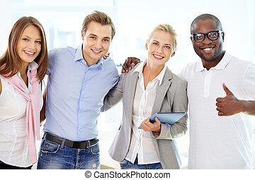 Friends in business - Portrait of successful friends doing...