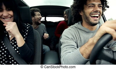 friends in car singing and dancing