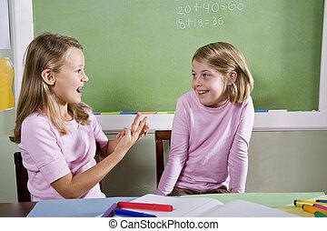 Friends in class talking - Back to school - 8 year old girls...
