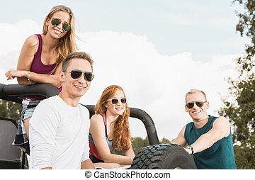 Friends in off road car
