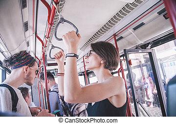 friends in public transport in Rome