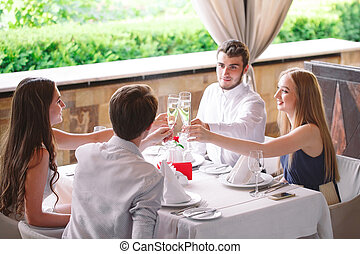 Friends in the restaurant having a toast.