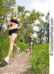 Friends jogging in a forest