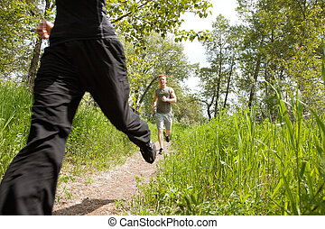 Friends jogging in forest - Happy men jogging at the park...