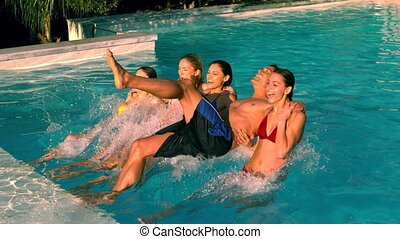 Friends jumping back into swimming