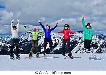 Friends jumping in mountains.