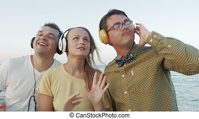 Friends Listening to the Music in Headphones