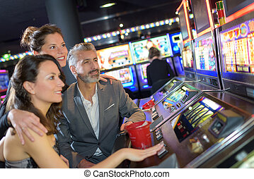 friends looking at the slot machine