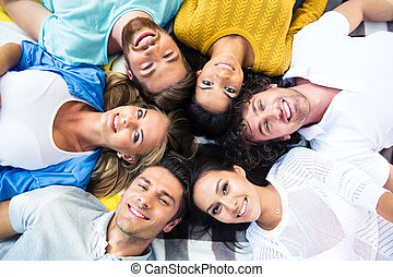 Friends lying together in a circle