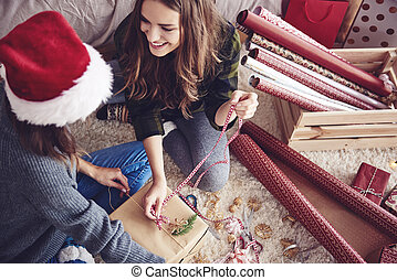 Friends making a christmas present together