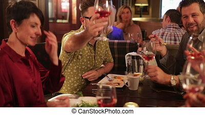 Friends Making a Toast - Mature male making a toast while ...
