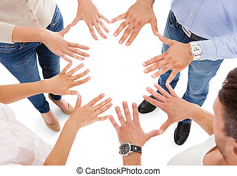 Friends Making Circle Shape With Hand - Group Of People...