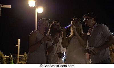 Friends making mobile selfie in night street