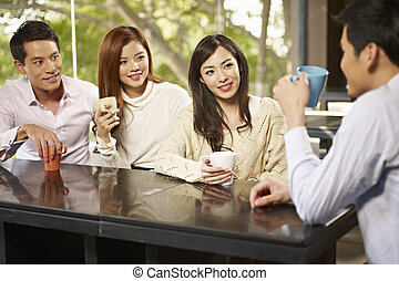 friends meeting in cafe