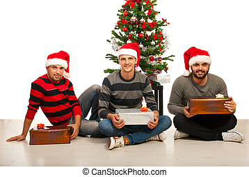 Friends men with Christmas gifts