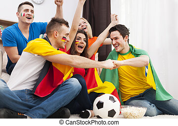 Friends of different nations supporting football team
