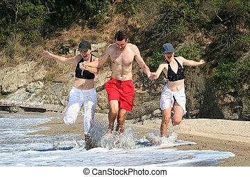 Friends on a beach - Young people running on the beach