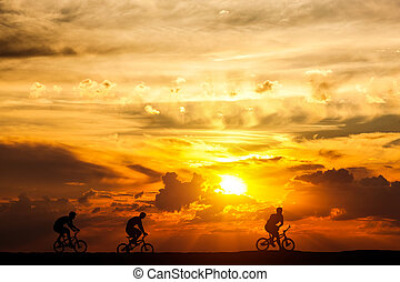 Friends on a bike trip at sunset. Active lifestyle, cycling hobby.