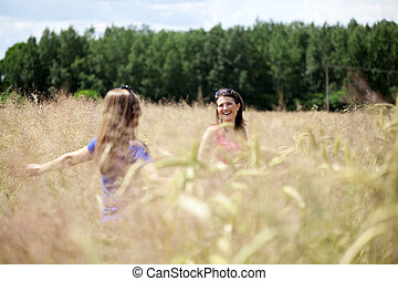 Friends on a field of grain