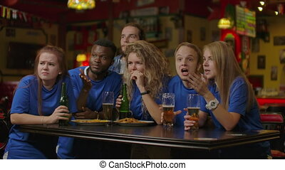 Friends Or Football Fans Watching Soccer At Bar. - Friends...