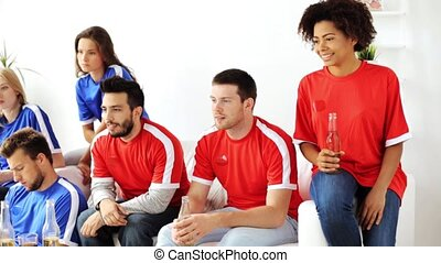 friends or football fans watching soccer at home