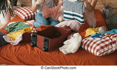 Friends Packing Red Suitcase