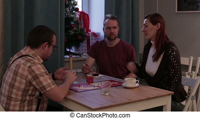 Friends play a board game in a cafe