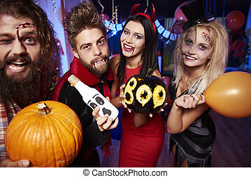 Friends posing with halloween decorations