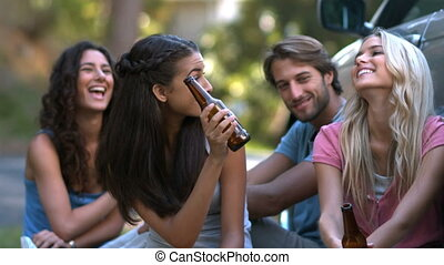 Friends raising a toast with beers