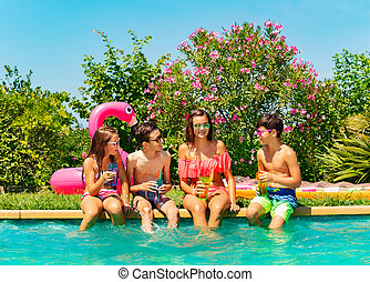 Friends relaxing and having fun during pool party