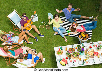 Friends relaxing at barbeque party