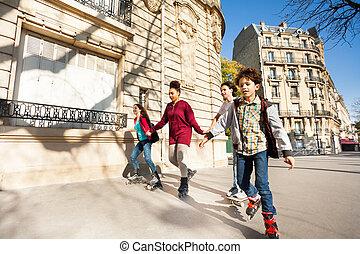 Friends rolls at the sidewalk of autumn city