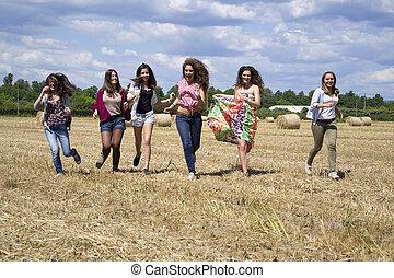 Friends running in a field.