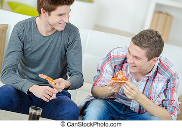 Friends sharing a pizza at home