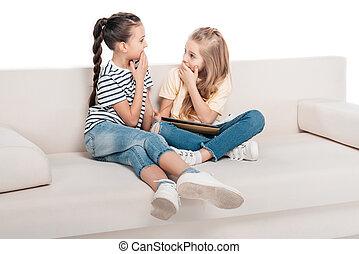 friends sharing secrets - Two cute girls sharing secrets...