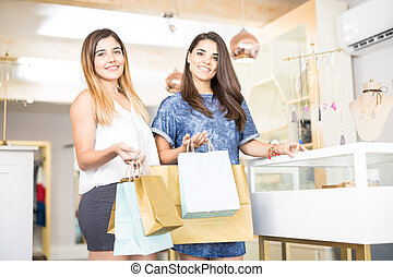 Friends shopping in a jewelry store