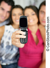 Friends showing the blank screen of a cellphone
