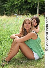 Friends sitting in a field