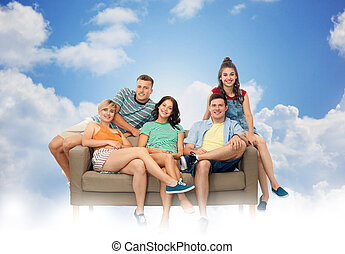 friends sitting on sofa over white background