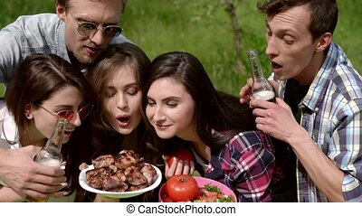 Friends smelling barbecue. Happy people at bbq party -...