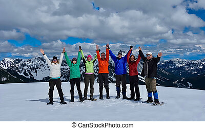 Friends snowshoeing in mountains.