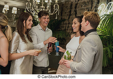 Friends Socialising Over Cocktails