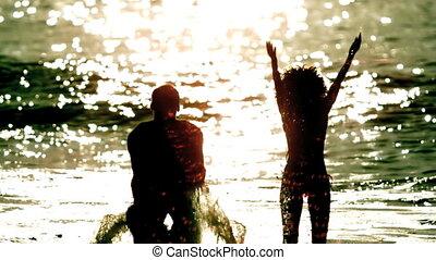 Friends splashing around in the sea