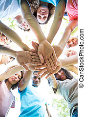 Friends stacking hands - Low angle view of multiethnic ...