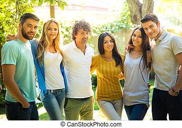 Friends standing outdoors
