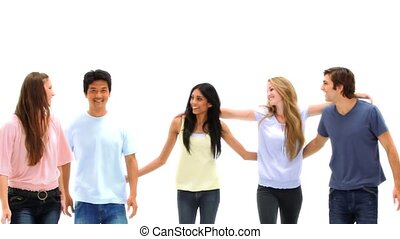 Friends standing shoulders to shoulders against white background